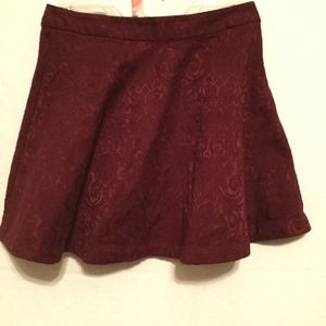 Forever 21 burgundy mini skirt in a size small.